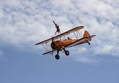 The Flying Circus Wingwalking Team, Shuttleworth Collection Family Air Show, Bedfordshire (IFM Photographic) Tags: img4023a breitlingstearman breitling stearman theflyingcircuswingwalker wingwalker wingwalking nikita aerosuperbatics canon 600d sigma70200mmf28exdgoshsm sigma70200mm sigma 70200mm f28 ex dg os hsm apo tele converter 2x af teleconverter oldwarden bedfordshire beds shuttleworthcollection shuttleworthhouse familyairshow airshow aircraft aeroplane plane airplane boeing