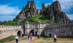 2018 - Bulgaria - Belogradchik Fortress (Ted's photos - Returns Late November) Tags: 2018 bulgaria cropped nikon nikond750 nikonfx tedmcgrath tedsphotos vignetting belogradchikfortress belogradchikrocks belogradchikbulgaria fortress gate bluesky blue people peopleandpaths pathsandpeople pathway arches