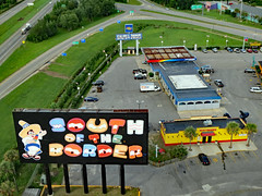South Of The Border Sign And Buildings. (dccradio) Tags: hamer sc southcarolina dilloncounty dillon pavement road interstate interstate95 i95 grass lawn greenery paved street tree trees foliage leaf leaves treelimbs treebranches branch branches billboard sign southoftheborder restrooms restroombuilding bathroom building architecture sunoco gasstation conveniencestore touristattraction travel sombrerotower roadsideattraction parking parkinglot car truck pickup suv boxtruck budget roadsigns signs pedro sombrero canon powershot elph 520hs