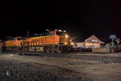 A Train In the Night (Night Stalker Photo Works, LLC.) Tags: bnsf tehachapi california wedge intermodal depot freightrailworks nighttime nightstalkerphotoworks ocf clock mood dramatic