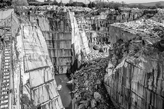 colapse (Ca*Rt) Tags: stone rock extract landscape collapse crane crag quarry estremoz bw marble blocks cliff portugal