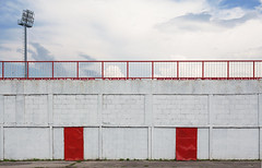 Football Stadium Exterior (dejankrsmanovic) Tags: wall abstract outdoor outside exterior reflector stadium building architectural architecture object day cloud weather white gate fence stub sport front facade structure door entrance sidewalk concrete