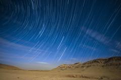 Lunar eclipse of the century under β-Cassiopeids (Noctræon) Tags: nikon sigma sigma14mm desert sky blue yellow gold d850 negev israel night stars startrails sand rock hill