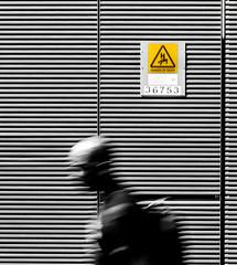 Danger of death!! (Jonathan Vowles) Tags: stripes man sign london death blur mono