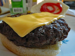 Cheeseburger For Lunch. (dccradio) Tags: lumberton nc northcarolina robesoncounty indoor inside meat food eat cheese meltedcheese hamburger cheeseburger hamburgerbun catsup ketchup corelle plate meal lunch dinner supper sandwich beef burger canon powershot elph 520hs photooftheday photo365 project365