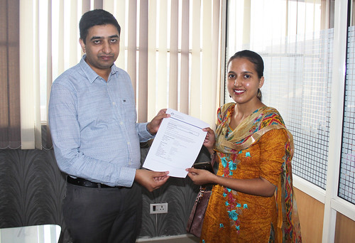 Mr. Gurvinder Kang (Director of West Highlander) handing over Australia Visitor Visa  to Kamalpreet Kaur