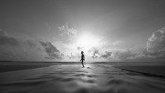 walk away (@_polod_) Tags: walk sunset kid beach holiday moody mood alone lonely silhouette nd filter long exposure 169 centered child away loneliness solo wide angle seascape noir water ocean blur