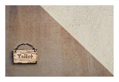 Sign (Daniela 59) Tags: 7dwf crazytuesdaytheme signsposteroradvertisements wall wednesdaywalls sign texture shadow toilet usakos danielaruppel