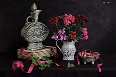 The Quiet Light of Dusk (Esther Spektor - Thanks for 12+millions views..) Tags: stilllife naturemorte bodegon naturezamorta stilleben naturamorta composition creativephotography summer dusk tabletop geranium bowl pitcher decanter box ribbon ceramics wicker pattern ambientlight white green pink red sage fuschia brown estherspektor canon