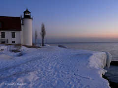 Spring Lighthouse Sunset (JamesEyeViewPhotography) Tags: pointbetsie lighthouse sunset lake michigan sky clouds spring colors trees snow ice water northernmichigan nature landscape lakemichigan greatlakes jameseyeviewphotography