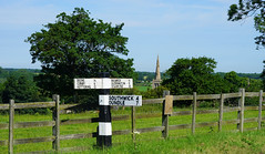 A view down to Bulwick Church (Jayembee69) Tags: northamptonshire northants britain british uk unitedkingdom gb english england bulwick village countryside country sign signpost fingerpost church spire fence field