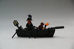 Captain Nordau's Rowboat (Robert4168/Garmadon) Tags: lego rowboat captainunriggednordau brethrenofthebrickseas black flag lantern oars monkey