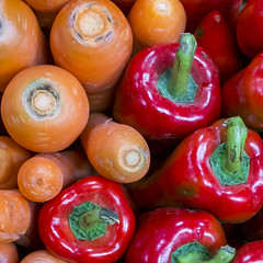 Carrots and red peppers (BryonLippincott) Tags: china asia yunnan asian chinese rural ruralscene ruralfarm lifestyle lifeinchina menglian market wetmarket food produce selling vendor agriculture local culture openair outside carrots peppers red orange vegetables macro closeup