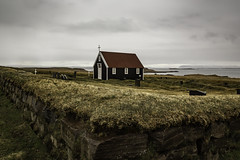 Church and Churchyard (Explored) (jessicalowell20) Tags: adventure blackchurch brown church churchyard clouds coastcoastline cross europe grass gray green headland iceland ocean overcast redroof remote rural sea spring stonewall summer travel weather westiceland white yellow