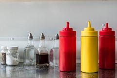 condiments_ (Eileen NDG) Tags: ketchup mustard vinegar frenchfries ontario ganonoque salt condiments