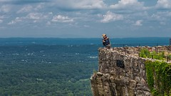 I think he jumped and she is getting the video (Oliver Leveritt) Tags: loversleap rockcity lookoutmountain georgia scenery woman candid nikond610 afsnikkor2470mmf28ged oliverleverittphotography