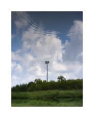 Summer Tower in Water (Sean Anderson Media) Tags: reflection pond water ripple tower celltower summer sky clouds pentaxq lofi lofilens pentax07mountshieldlens summersky lofilook plasticlens blurry softfocus illinois