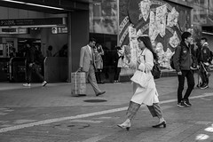 One Piece At A Time (burnt dirt) Tags: asian japan tokyo shibuya station streetphotography documentary candid portrait fujifilm xt1 bw blackandwhite laugh smile cute sexy latina young girl woman japanese korean thai dress skirt shorts jeans jacket leather pants boots heels stilettos bra stockings tights yogapants leggings couple lovers friends longhair shorthair ponytail cellphone glasses sunglasses blonde brunette redhead tattoo model train bus busstation metro city town downtown sidewalk pretty beautiful selfie fashion pregnant sweater people person costume cosplay boobs windy shadow reflection