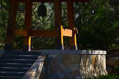 bonshō at sasebo (johngpt) Tags: fujifilmxt1 bonshō fujinonxf55200mmf3548rlmois bell silhouette sasebojapanesegarden abqbotanicgardens places