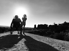 the west is the best (KevinIrvineChi) Tags: disabilitypride disabledandproud disabledparenting brim wheels daughter natural nature sunny blackandwhite wheeling rolling walking hats hat hot windows window outdoors outside day afternoon late sun trail path silhouette wheelchair mother mom girl moab utah park national arches bw bnw noiretblanc monochrome iphoneiphone7