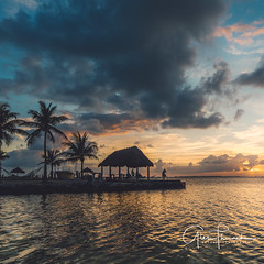 Livin' On Tiki Time (Thüncher Photography) Tags: sony a7r2 sonya7r2 ilce7rm2 fe1635mmf4zaoss fx fullframe scenic landscape waterscape nature outdoors sky clouds colors sunset reflections tropical island tikihut floridakeys keylargo florida beach ocean overseashighway
