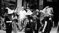 Hatters outing 03 (byronv2) Tags: street oldtown peoplewatching blackandwhite candid edinburgh blackwhite bw monochrome edimbourg scotland woman girl grassmarket hat sortinghat harrypotter henparty costume group