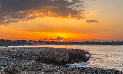 Between Two Hills (nicklucas2) Tags: menorca sonxoriguer seascape beach rock sea sun cloud sunrise lava travel hill