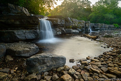 Nature's Design (scottymanphoto) Tags: log falls oklahoma ozark tourist stones shadows creek visitor waterfall ok rockbed sky driftwood white sunrise vignette vignetting arkansas summer country forest boulder unitedstates branch horizon tranquility landscape american nature water glowing flowing trees crawfordcounty attraction scenic outdoors america tranquil sunlight rocky stream popular morning natural unique boulders rocks early mountainforkcreek bluffs colorful shinning beautiful bluff outside relaxing golden pool naturaldam usa tourism longexposure green