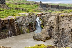 Vigabjargsfoss in Jokulsargljufur (Einar Schioth) Tags: vigabjargsfoss vígabjargsfoss vígabjarg river rocks rock water waterfall sky summer shore day canon clouds cloud coast cliff canyon nationalgeographic ngc nature landscape lake jokulsargljufur jökulsá jokulsaafjollum jokulsarthjodgardur katlar photo picture outdoor iceland ísland einarschioth