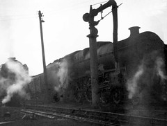 Apologies for lousy negative of Jubilee & A1 or A2 on shed, possibly Neville Hill, Leeds, Oct 1964. (Dave Wragg) Tags: jubilee jubileeclass lms stanier lner classa1 classa2 nevillehill leeds steam loco locomotive railway