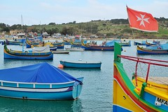 Marsaxlokk (Douguerreotype) Tags: boat luzzu flag malta water