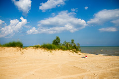 At the Beach (Lester Public Library) Tags: beach beaches sand sky clouds water greatlakes lakemichigan lake tworiverswisconsin tworivers neshotahbeach neshotah neshotahpark wisconsin lesterpubliclibrarytworiverswisconsin readdiscoverconnectenrich