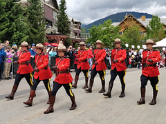 Marching Mounties (Ruth and Dave) Tags: mounties rcmp royalcanadianmountedpolice police whistler whistlervillage whistlerblackcomb olympicplaza marching parade formation stepping uniform red canadian canadaday