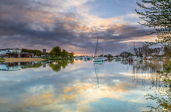 Hint Of Sunrise (nicklucas2) Tags: christchurch quay dorset river stour cloud sunrise reflection water boat yacht tree