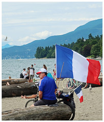 So...How'd YOUR World Cup go? (HereInVancouver) Tags: tricolors frenchflag beach log man worldcup soccerfan vancouverswestend candid mountains ocean englishbaybeach vancouver bc canada canong9x thingstodobythewater