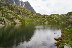 20180717-23-Colourful hikers reflected in Lac des Cheserys (Roger T Wong) Tags: 2018 alps france laccheserys montblanc rogertwong sel2470z sony2470 sonya7iii sonyalpha7iii sonyfe2470mmf4zaosscarlzeissvariotessart sonyilce7m3 tmb tourdumontblanc bushwalk hike mountains outdoors reflection tramp trek walk water