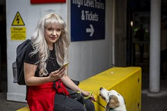 Woman's Best Friend (Leanne Boulton) Tags: urban street candid spontaneous portrait portraiture streetphotography candidstreetphotography streetportrait candidportrait eyecontact candideyecontact streetlife colourful woman female girl face eyes expression smile smiling happy happiness mobile phone pet dog pooch animal sitting travelling public transport train station tone texture detail red yellow depthoffield bokeh naturallight outdoor light shade city scene human life living humanity society culture people lifestyle canon canon5dmkiii 70mm ef2470mmf28liiusm color colour glasgow scotland uk