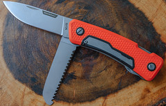 Multi-utility Pocket Knife (AM_DB) Tags: knife sharp multiutilitypocketknife swissknife pocketknife solognac cuttingedge essential travellerskit expeditionaccessory orange hacksaw safety protection beprepared productphotography