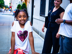 Mother Love (Mildred Alpern) Tags: girl tshirt heart woman mother love pride street nyc depthoffield smile pose candid braids