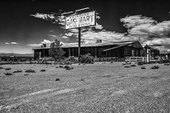 SR 361, Gabbs, Nevada (paccode) Tags: solemn mojave sand landscape desert bushes brush blackwhite nevada quiet clouds forgotten monochrome shack scary sky creepy sign abandoned dirtroad serious gabbs unitedstates us