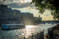 Boats moving along the Seine river.