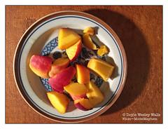 Pieces of Summer (Doyle Wesley Walls) Tags: lagniappe 7468 iphonephoto peach fruit color plate shadow food doylewesleywalls cuttingboard juicy