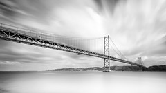 Hanging Steel (frank_w_aus_l) Tags: tejo portugal lisbon lissabon monochrome nikon d800 1635 nikkor bridge ponte 25deabril longexposure water reflection stream sky clouds pt bw black white himmel monochrom depth april river