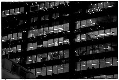 Dilbert by Night (Harald Philipp) Tags: architecture concretejungle building skyscraper glass officebuilding structure urban citycenter city street office cubicles people geometric destination travel adventure blackandwhite bw blackwhite monochrome schwarzweiss nocolor dark shadows contrast kodak portra 35mm film analog analogue filmphotography longexposure primelens nikon nikkor f6 night nightshot australia sydney dilbert