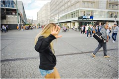 Click! Click! Click! (Steve Lundqvist) Tags: travel trip viaggio traveling model urban city urbanscape portrait persone ritratto fashion moda mood attractive beauty crossing street road streetphotography cityscape background nikon d700 hand stop action berlin berlino sunlight sun light golf ad advertising girl sidewalk footpath sweater jacket sport sportswear germany germania deutschland picture downtown grooming