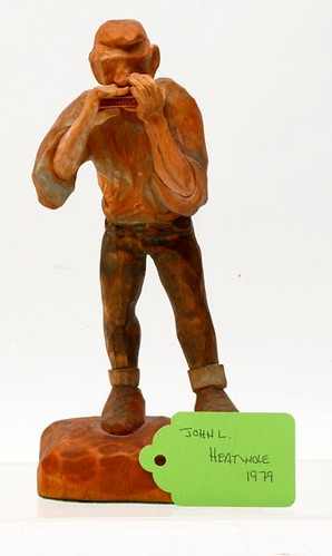 "1979 John L. Heatwole (1948-2006) wood carving Man Playing Harmonica, 9"" h. ($728.00)"