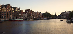 Amsterdam. (alamsterdam) Tags: amsterdam canal boating houseboats reflection architecture bridge towers amstel