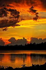 Storm Clouds at Dusk (Bob's Digital Eye) Tags: bobsdigitaleye canon canonefs55250mmf456isstm clouds dusk flicker flickr laquintaessenza lake lakesunsets may2018 reflections silhouette sky skyline skyscape stormclouds sunset sunsetoverwater t3i water