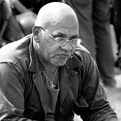 Bald heads, forgetful of their sins. (Neil. Moralee) Tags: neilmoralee steamrally2018neilmoralee man bald face close portrait glasses uniform staem rally norton fitzwarren hair loss dogtag military old mature black white bw bandw blackandwhite mono monochrome stare sitting outdoor people neil moralee olympus omd em5 candid baldness solidier trooper
