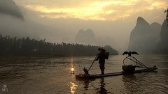 China (capiotti) Tags: yangshuo guilin cormorant southeastasia south southchina china chinese river water fisherman fishing mountains